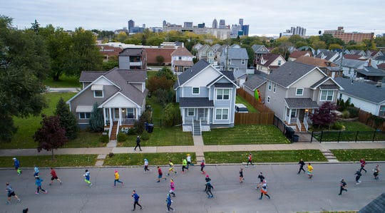 Marathoners run through Mexican Town near 18th and Bagley during the 41st Annual Detroit Free Press Marathon in Detroit on Sunday, Oct. 21, 2018.