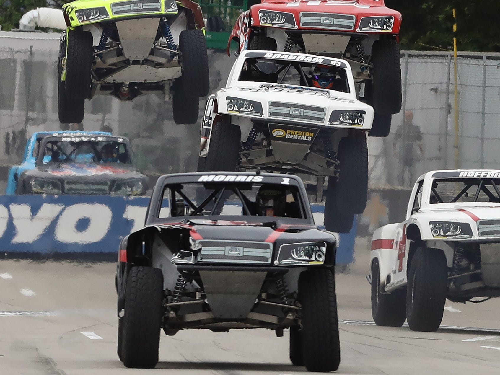 Speed Energy Stadium Super Trucks series drivers jump over ramp one near turn one during the 2018 Chevrolet Detroit Grand Prix on Belle Isle weekend in Detroit, Michigan on Saturday, June 2, 2018.