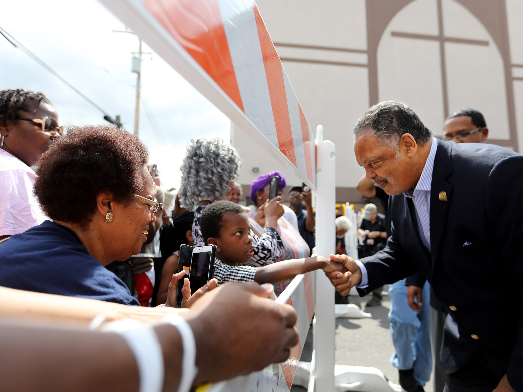 Rev. Jesse Jackson greets the crowd at the public viewing for Aretha Franklin at New Bethel Baptist church, her family church,  in Detroit on Thursday, Aug. 30, 2018.