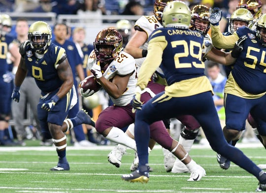 Running back Mohamed Ibrahim (24) carries the ball in last year's Quick Lane Bowl won by Minnesota 34-10 at Ford Field.