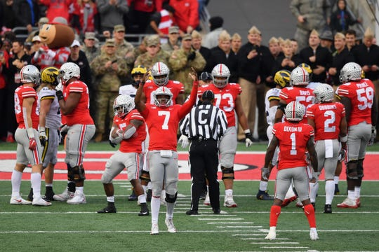 Dwayne Haskins of the Ohio State Buckeyes celebrates with the crowd as time winds down in the fourth quarter against the Michigan Wolverines.