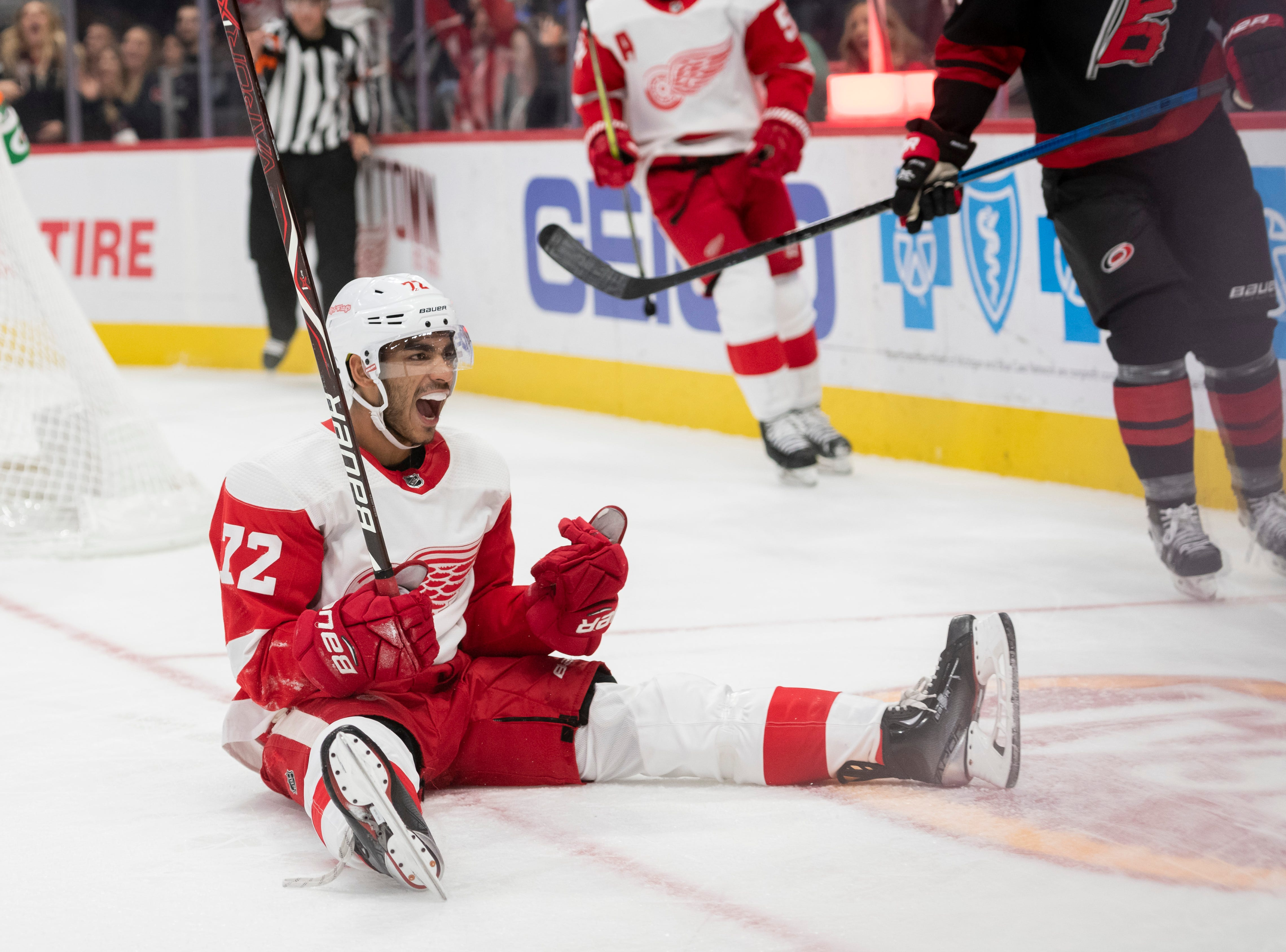 Detroit center Andreas Athanasiou celebrates after scoring on Carolina goaltender Petr Mrazek in the third period.              Photos are of the Detroit Red Wings vs. the Carolina Hurricanes, at Little Caesars Arena, in Detroit, October 22, 2018.  (David Guralnick / The Detroit News)