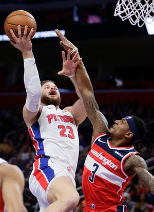 Pistons forward Blake Griffin (23) rises over Wizards guard Bradley Beal for a basket during the first half on Wednesday.