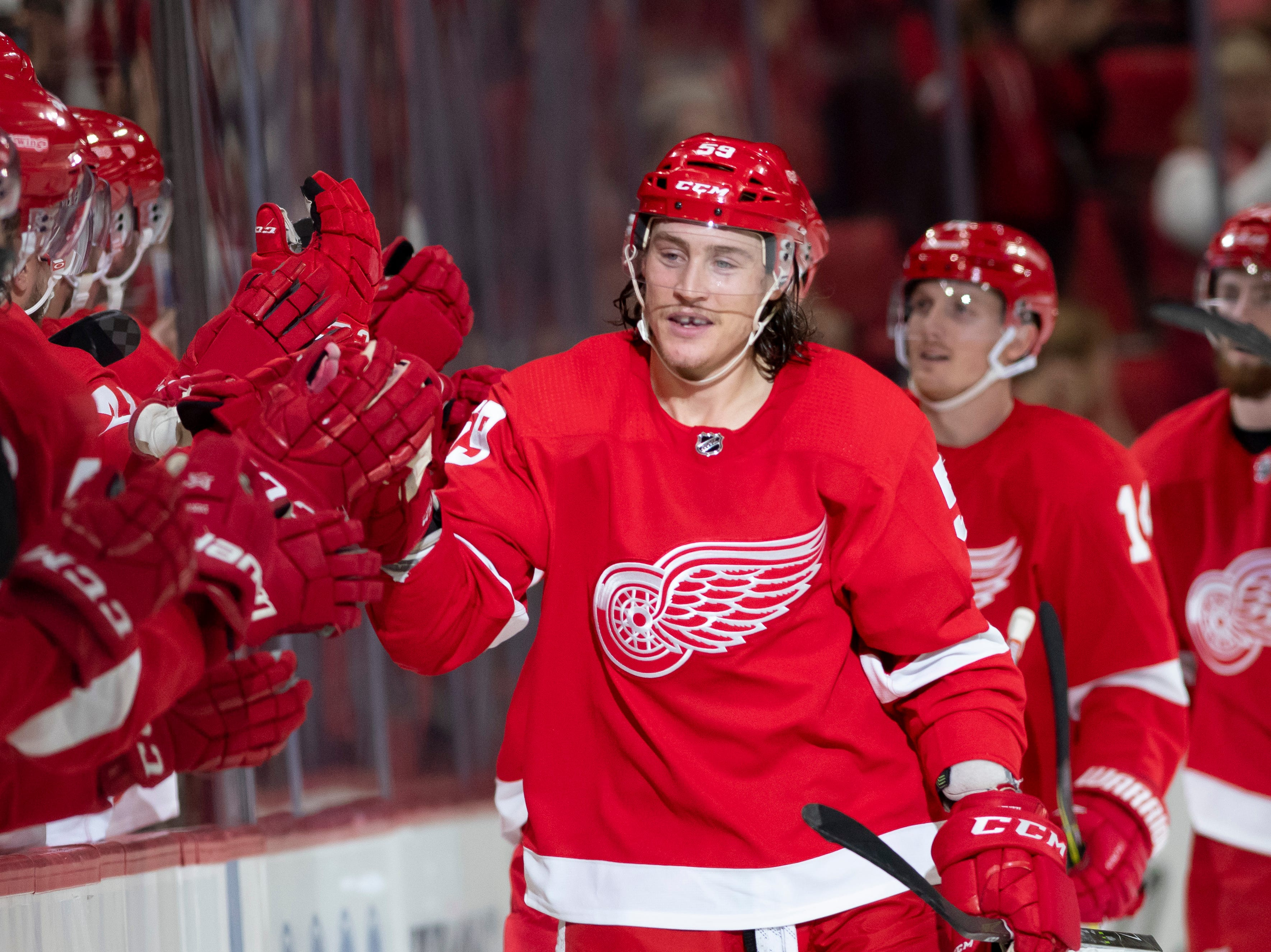 Detroit left wing Tyler Bertuzzi celebrates a goal with his teammates.               Photos are of the Detroit Red Wings vs. the Columbus Blue Jackets, at Little Caesars Arena, in Detroit, October 4, 2018.  (David Guralnick / The Detroit News)