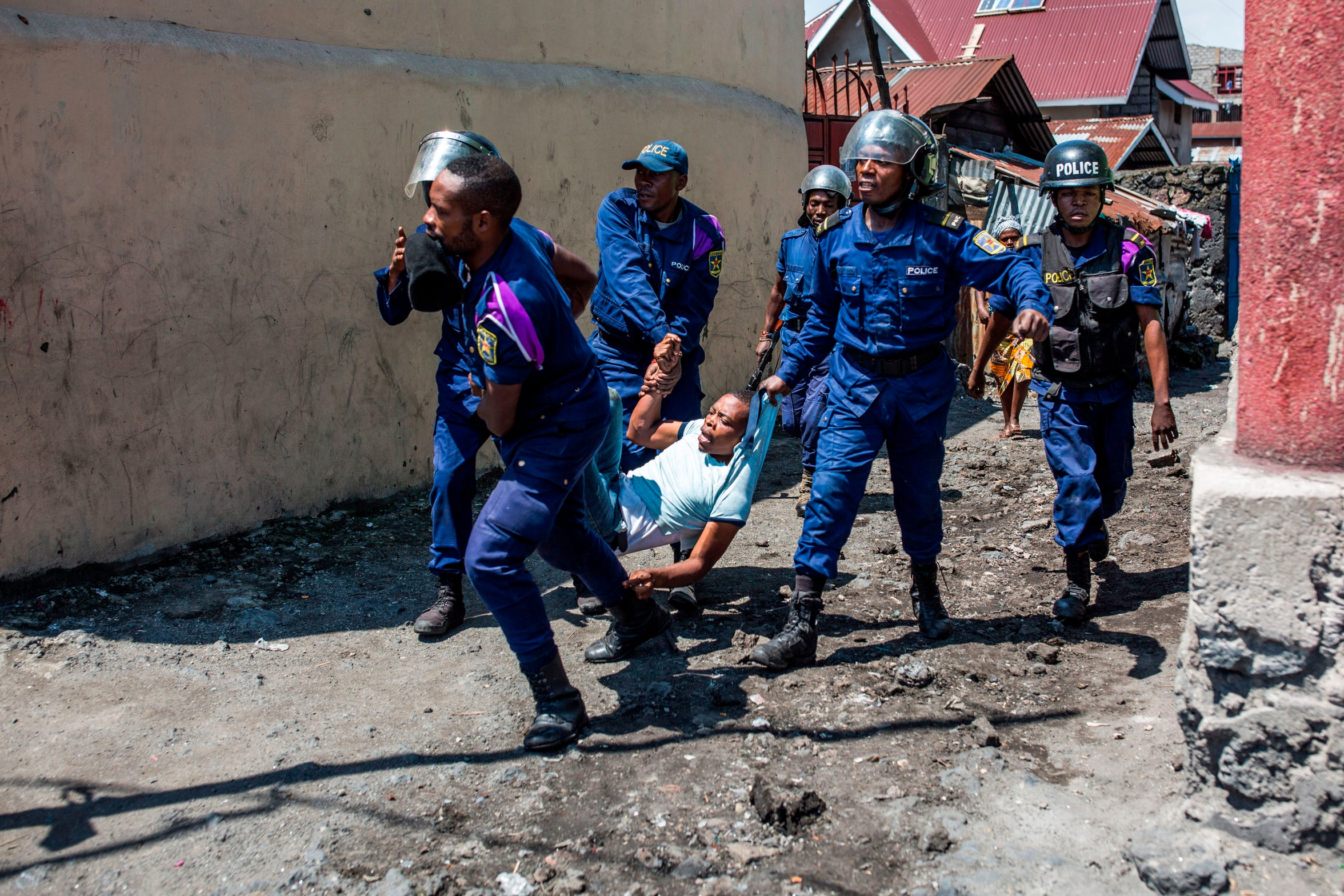 Congolese National Police arrest a man at Majengo neighborhood in Goma, on Dec. 27, 2018.