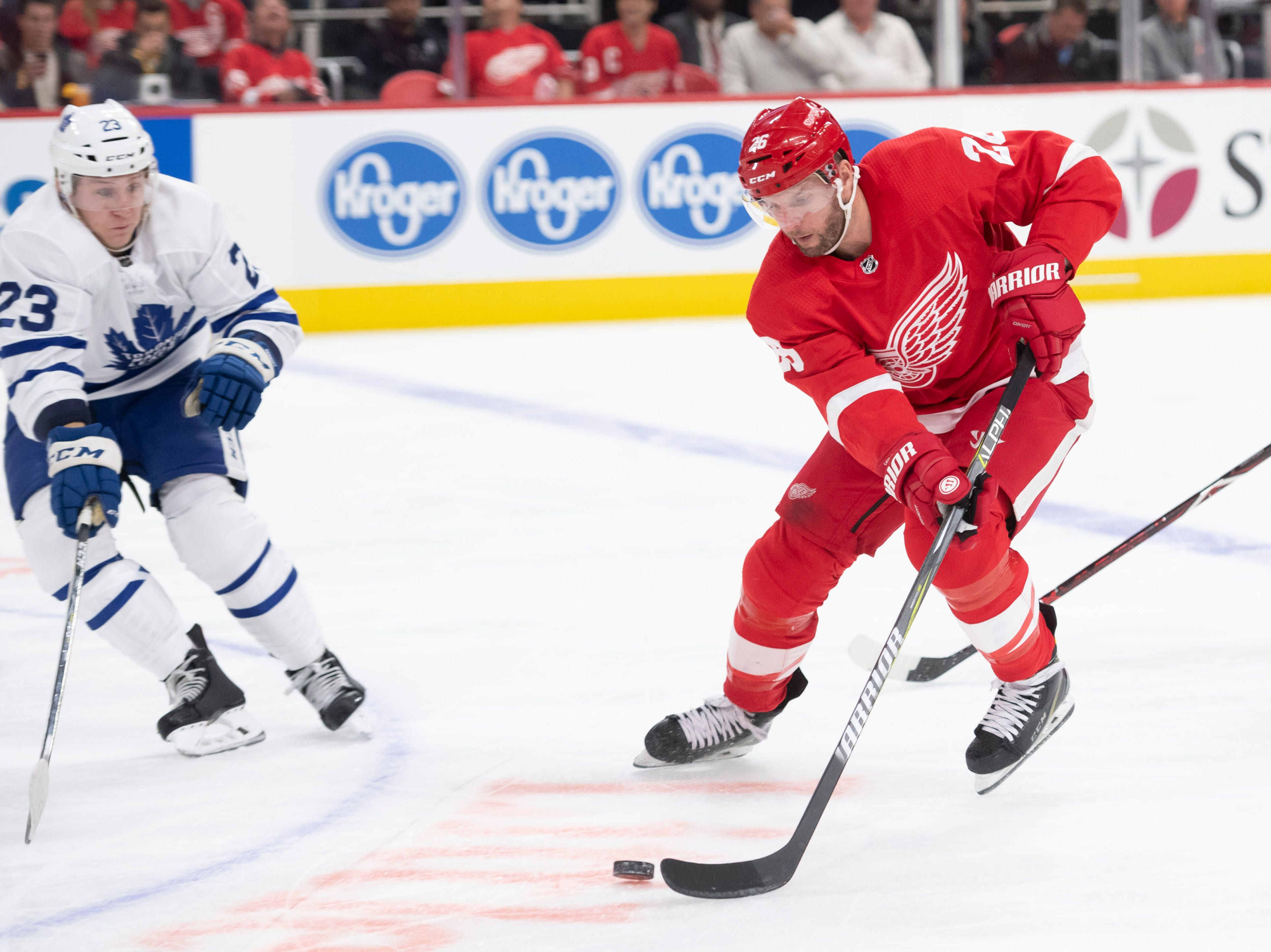 Detroit left wing Thomas Vanek tries to move the puck [ast Toronto defenseman Travis Dermott the second period.                  Photos are of the Detroit Red Wings vs. the Toronto Maple Leafs, at Little Caesars Arena, in Detroit, October 11, 2018.  (David Guralnick / The Detroit News)