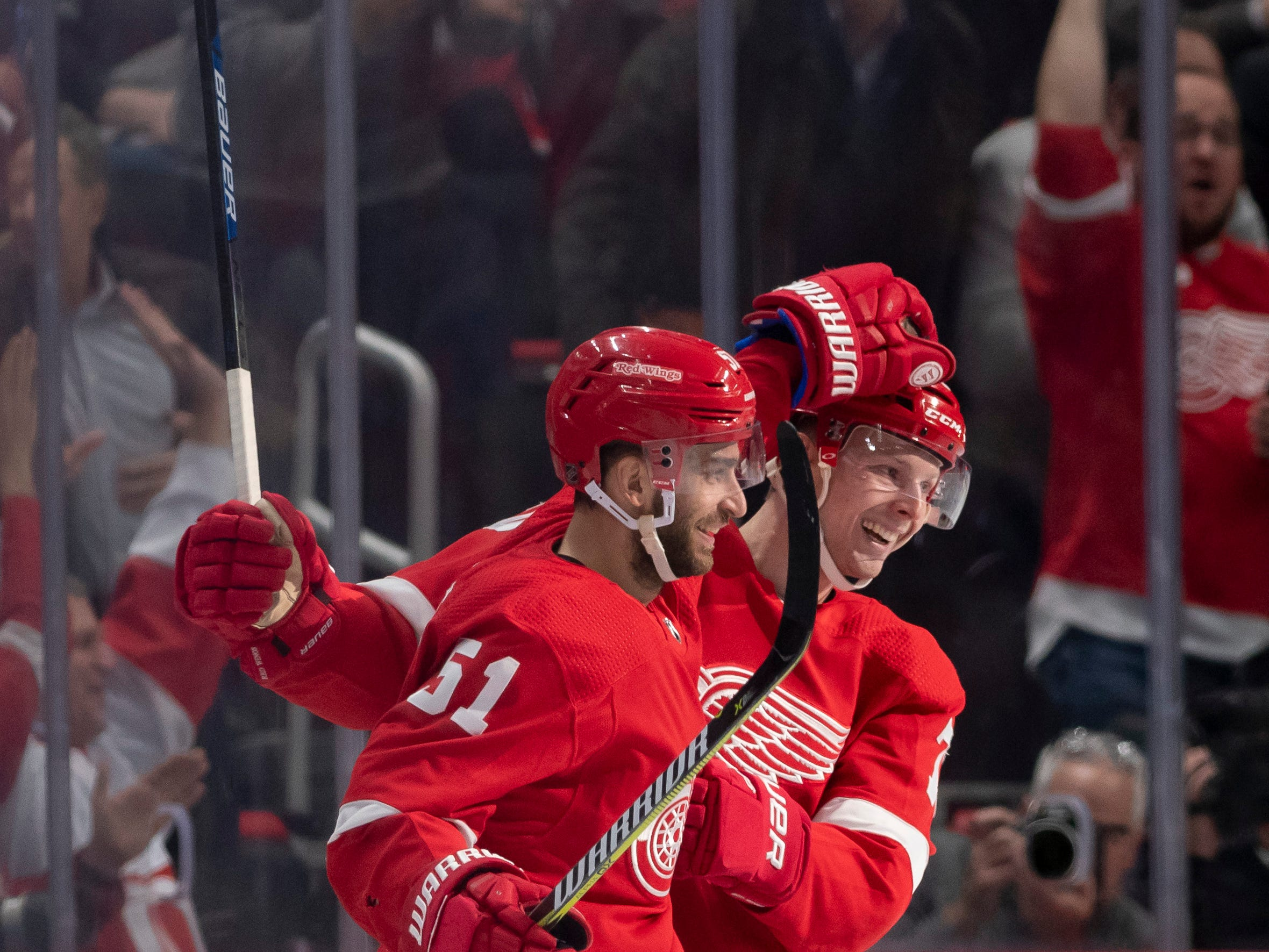 Detroit center Frans Nielsen, left, and center Christoffer Ehn celebrate Nielsen's second goal of the game in the second period.             Photos are of the Detroit Red Wings vs. the Tampa Bay Lightning, at Little Caesars Arena, in Detroit, December 4, 2018.  (David Guralnick / The Detroit News)