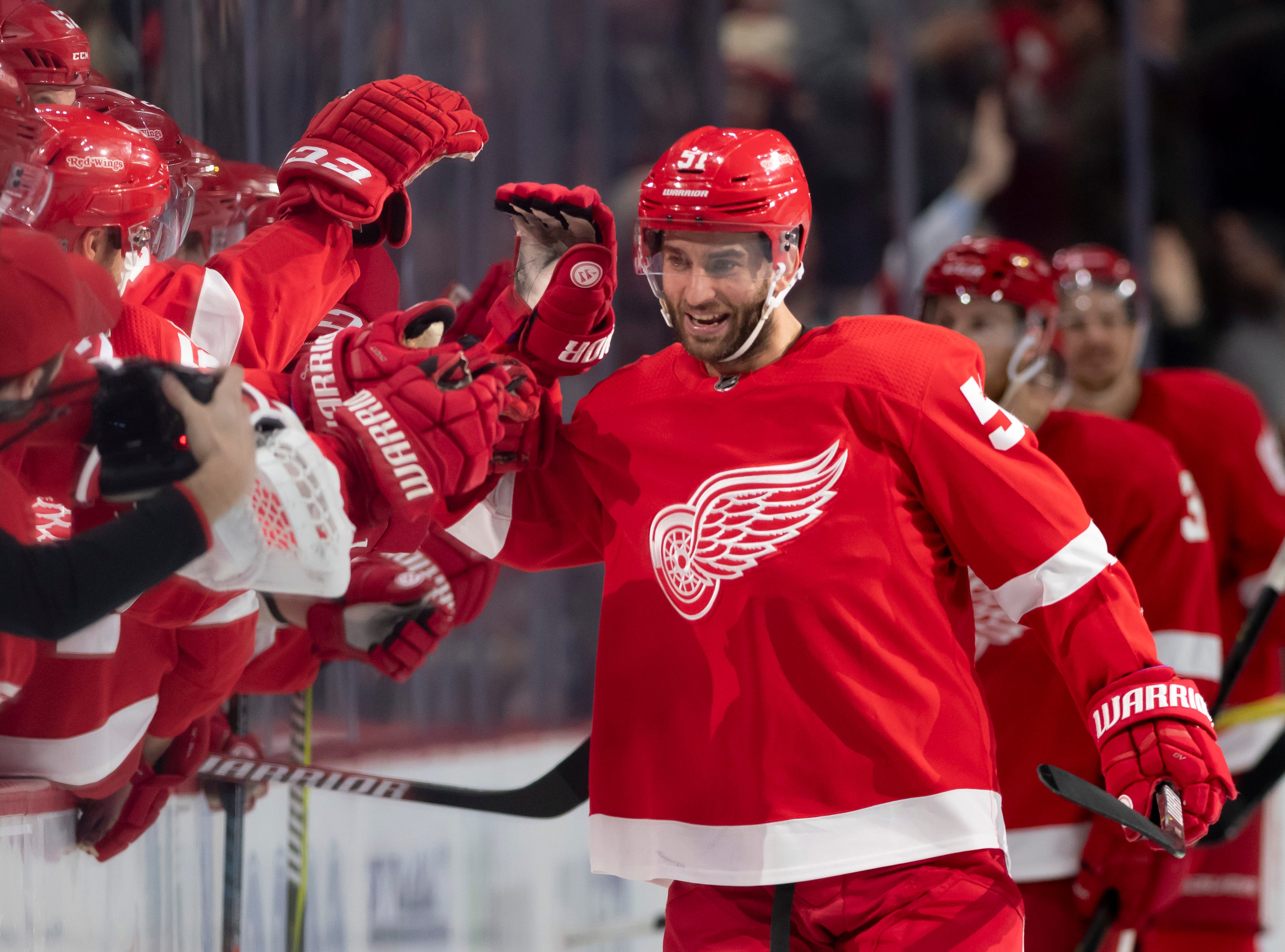 Detroit center Frans Nielsen gets high fives from his teammates after scoring a hat trick in the second period.             Photos are of the Detroit Red Wings vs. the Tampa Bay Lightning, at Little Caesars Arena, in Detroit, December 4, 2018.  (David Guralnick / The Detroit News)