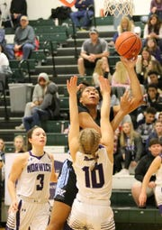 Saniaa Wilson of Bishop Kearney goes up for a shot as Emily Evans (10) and Taylor Hansen (3) of Norwich defend during a girls quarterfinal at the Josh Palmer Fund Elmira Holiday Inn Classic on Dec. 27, 2018 at Elmira High School.