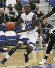 Saint Mary's Chavaughn Lewis drives toward the basket against  Bishop Kearney during the Josh Palmer Fund tournament at Horseheads Middle School in 2010. Lewis was MVP at the tourney and went on to become the career scoring leader for Marist University.
