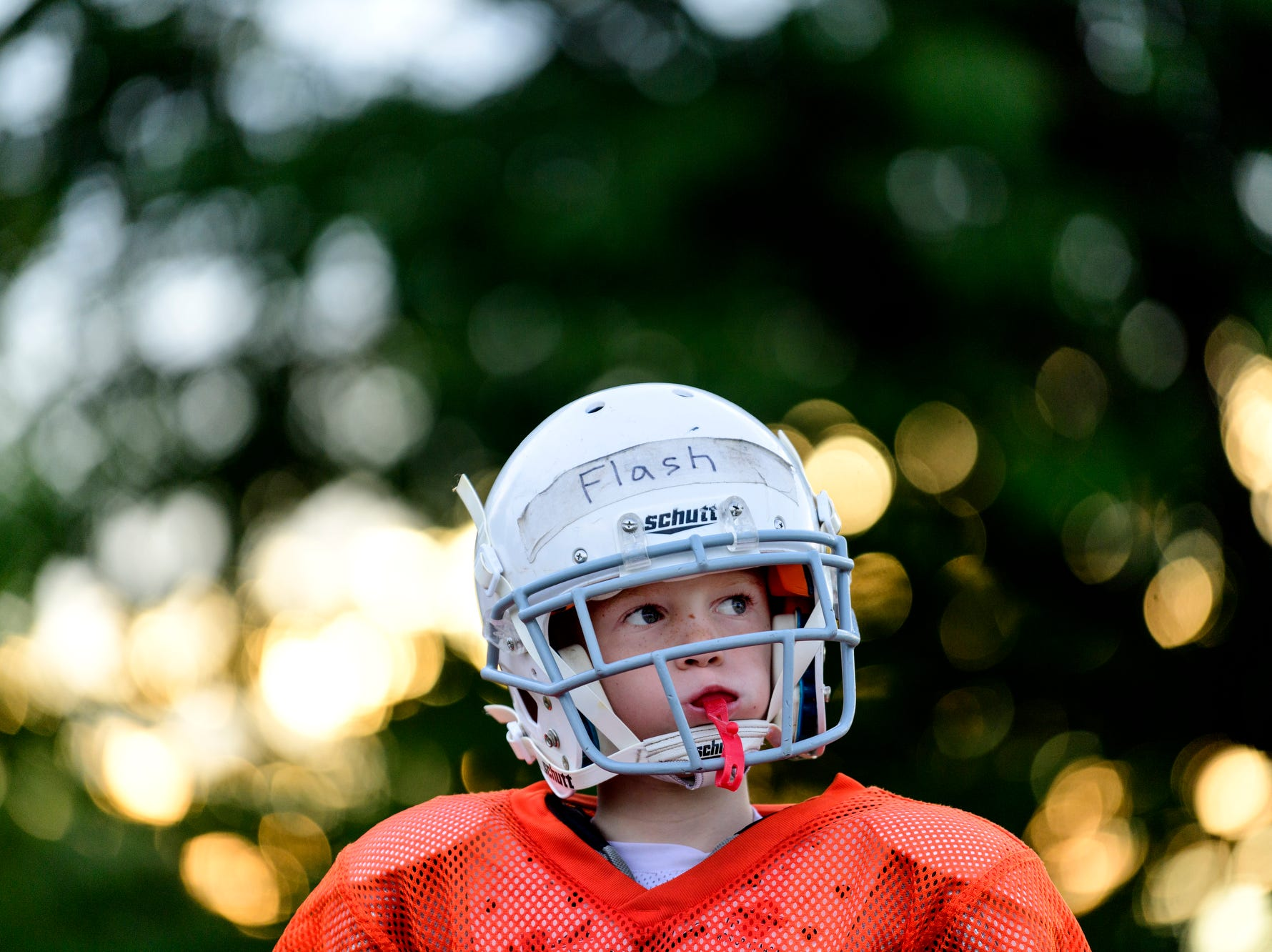 "Max ""Flash"" Boehman plays quarterback during practice with the Broncos, his Evansville Junior League Football team, at Howell Park in Evansville, Ind., Tuesday evening, Sept. 11, 2018."