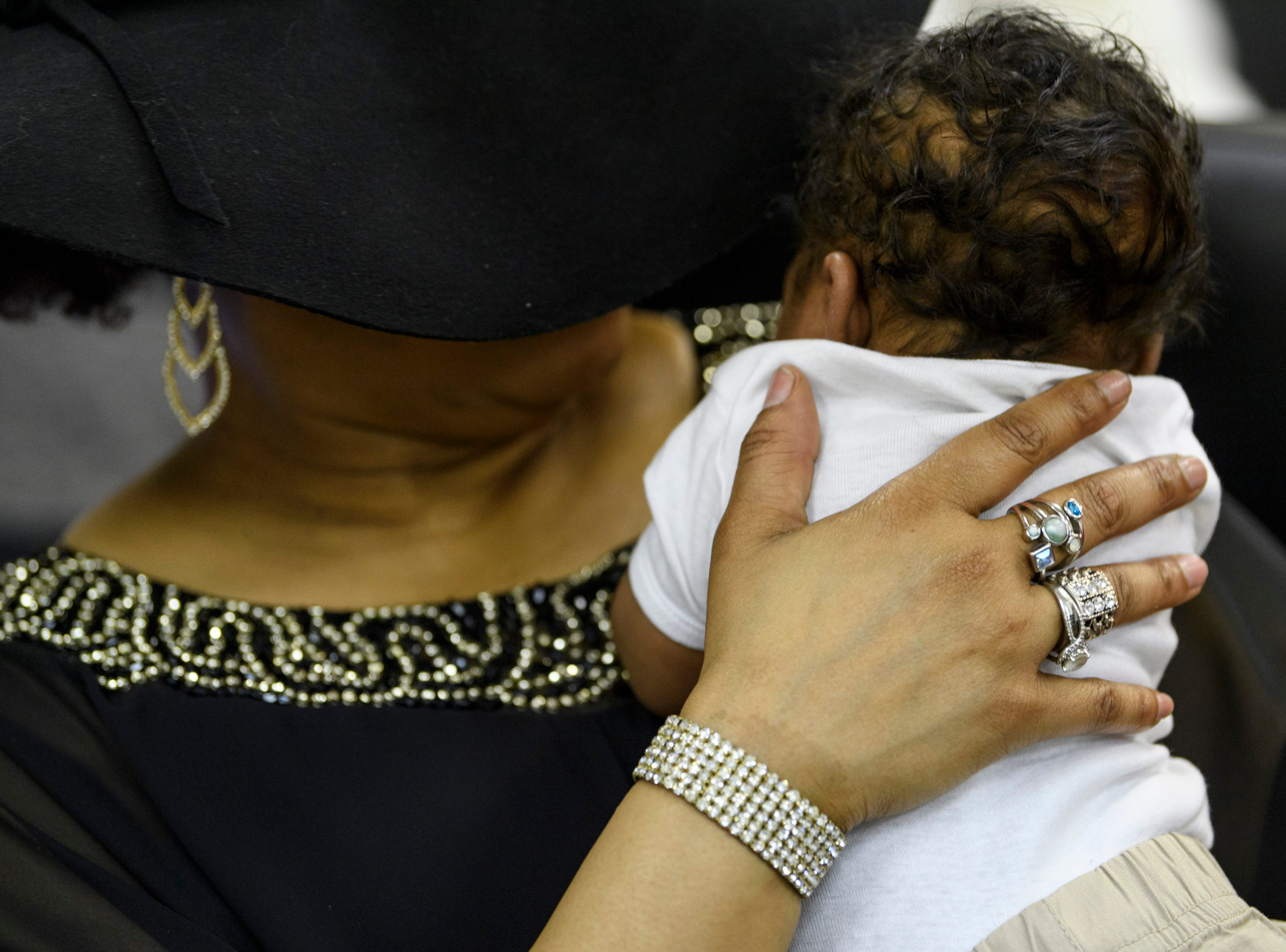 Pageant participant Mariama Black-Wilson holds her one-month-old grandson Ja'Zeon during a dinner break at the 5th Annual Glamorous Grandmother's Pageant held at the Greater St. James Community Recreation & Education Center in Evansville, Ind., Sunday, Feb. 4, 2018. Black-Wilson has seven children, three of them adopted, and three grandchildren.