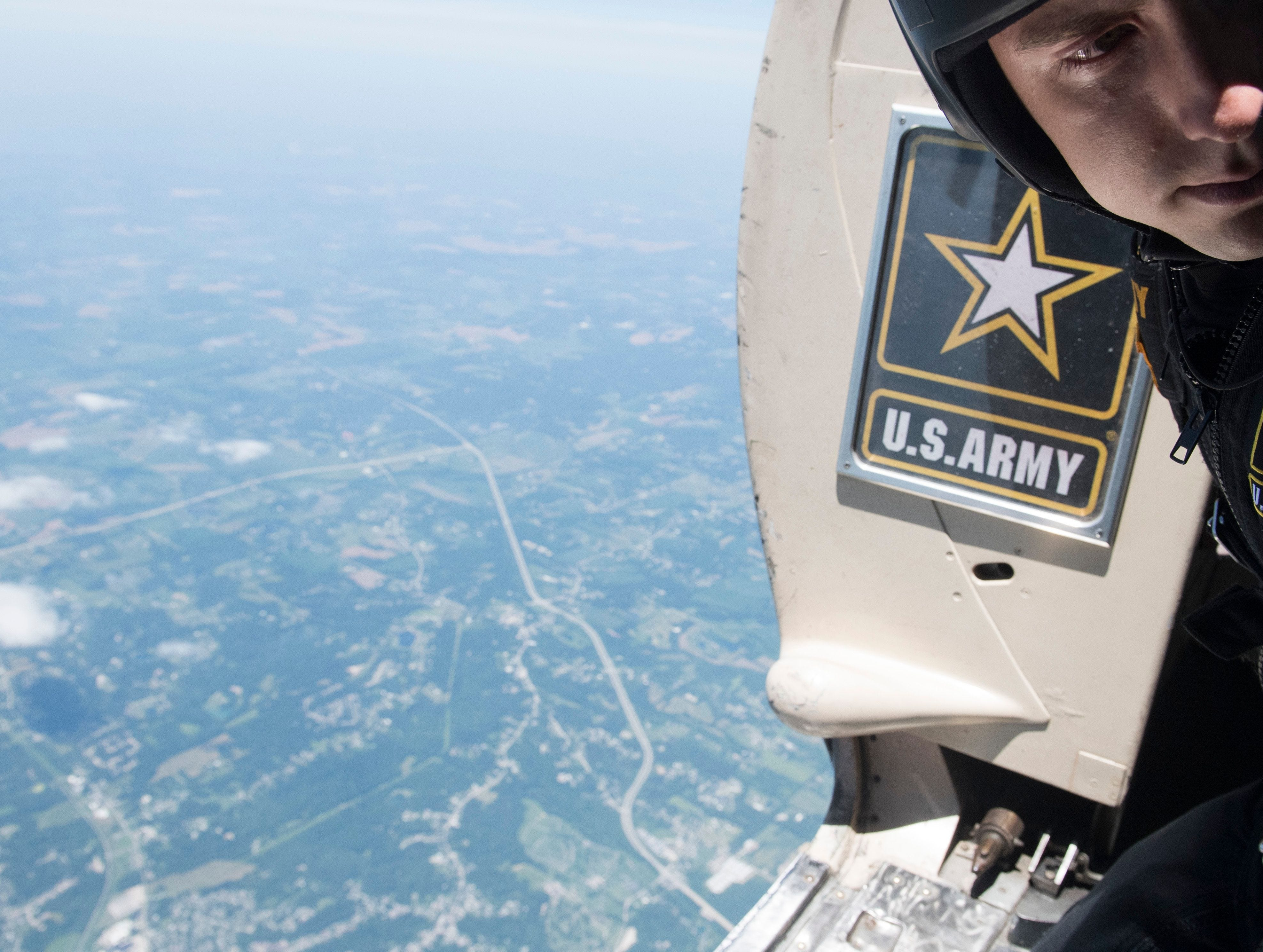 SGT Nicholas Grimm looks back at a teammate before leaping out of a Fokker C-31A towards downtown Evansville during the 2018 ShrinersFest.
