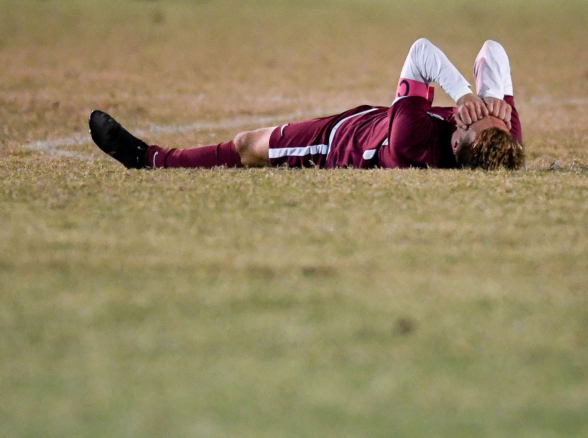 Henderson County's Max Wawrin (11) reacts after losing to Hopkinsville 2-0 as the Henderson County Colonels play the Hopkinsville Tigers in the regional final at Madisonville-North Hopkins High School Thursday, October 18, 2018.