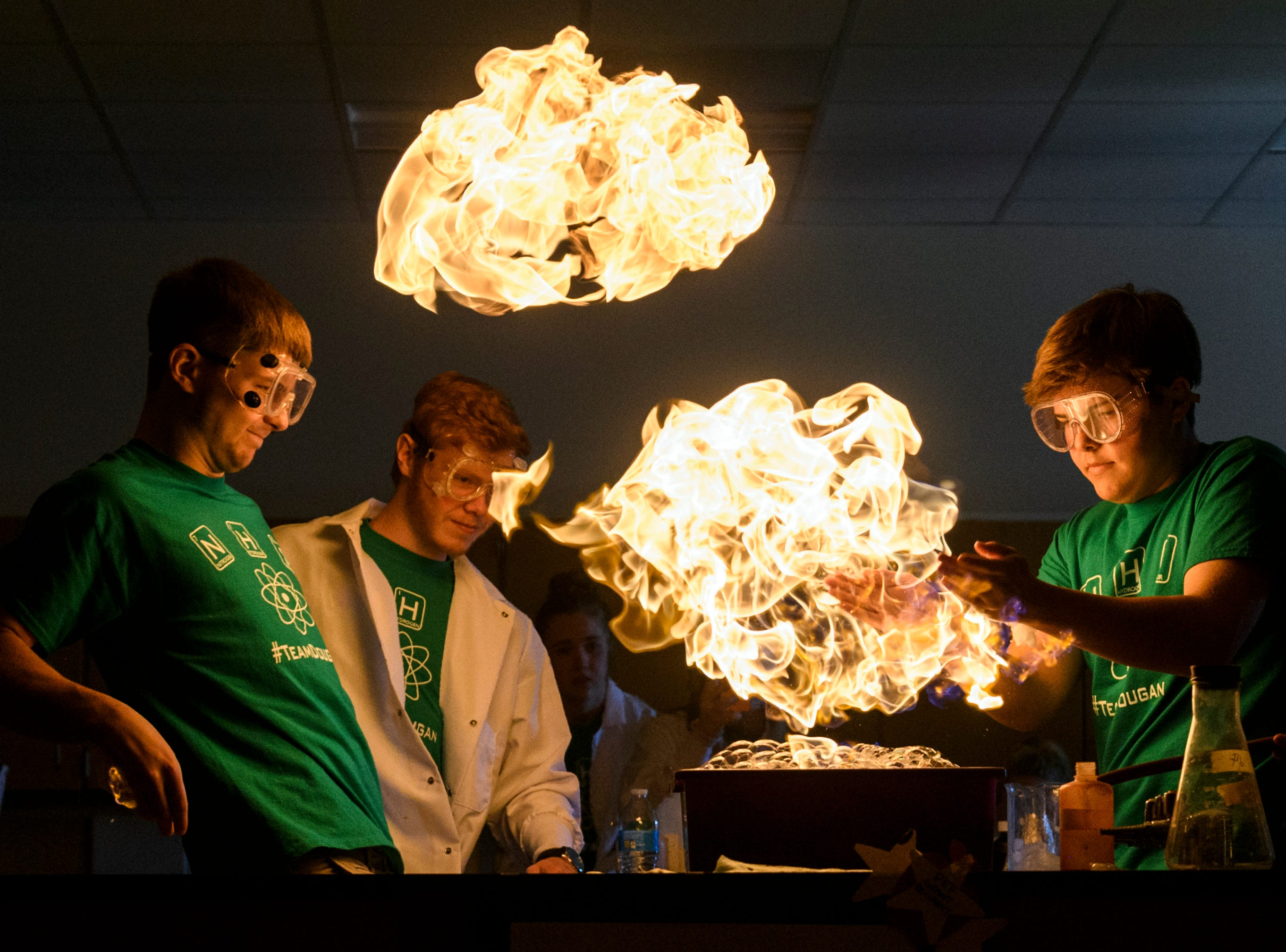North High School seniors Ryan Huebner (left to right), Alex Mosteller and Hatch Gerth perform a methane gas bubble experiment during a science show put on for visiting Delaware Elementary School first-graders inside a science lab at the high school in Evansville, Ind., Wednesday, April 18, 2018. Throughout the school year, NHS Science teacher Brian Dougan's classes have put on a student-run show for all of their feeder schools, which also includes Evans Elementary, Oak Hill Elementary, Scott Elementary, Vogel Elementary and North Junior High School.