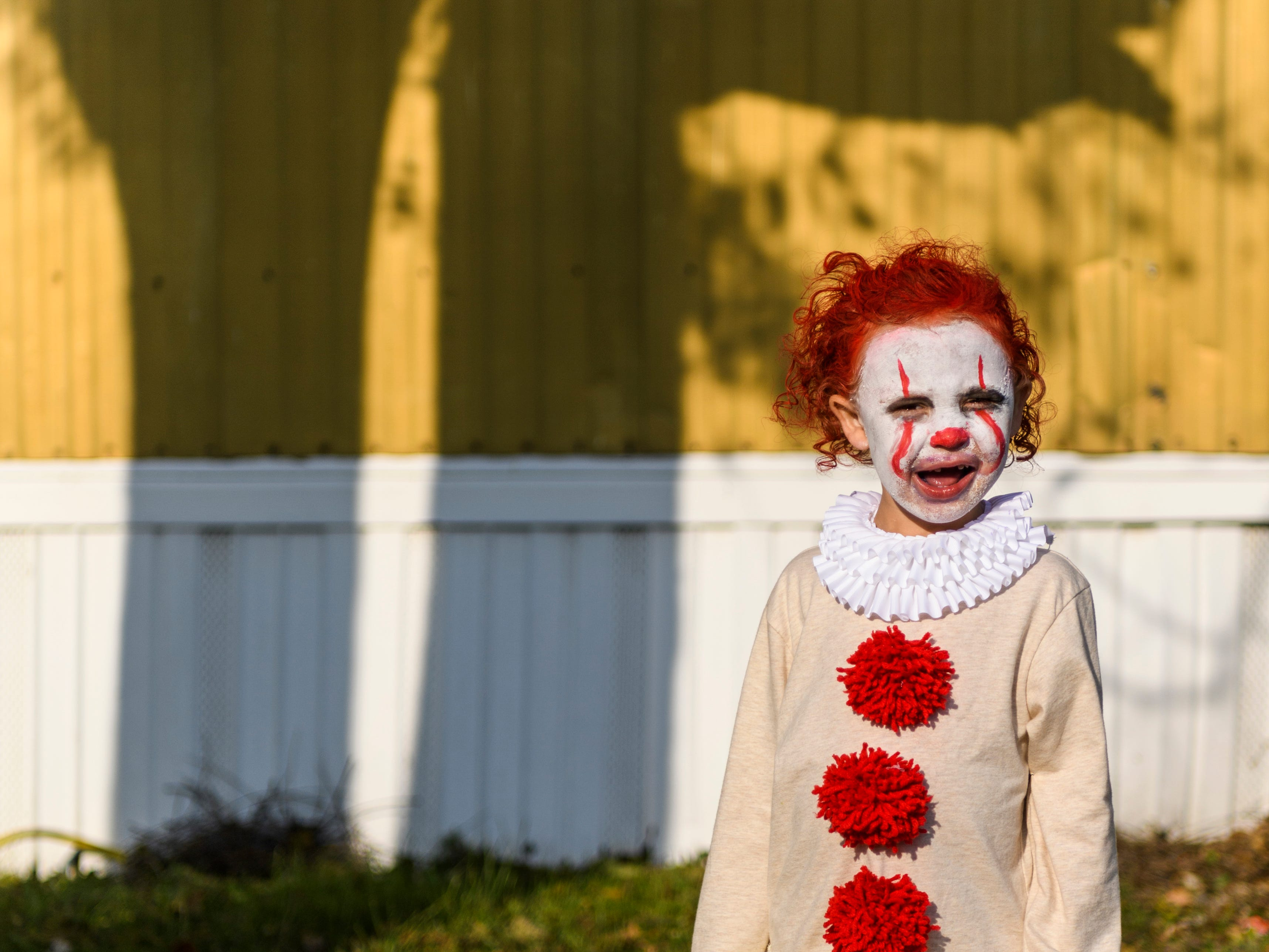"Jensen Breamer, 3, is dressed as Pennywise, a character from Stephen King's ""It,"" during the Halloween Trunk or Treat Extravaganza on Powell Street in Henderson, Ky., Saturday, Oct. 27, 2018."