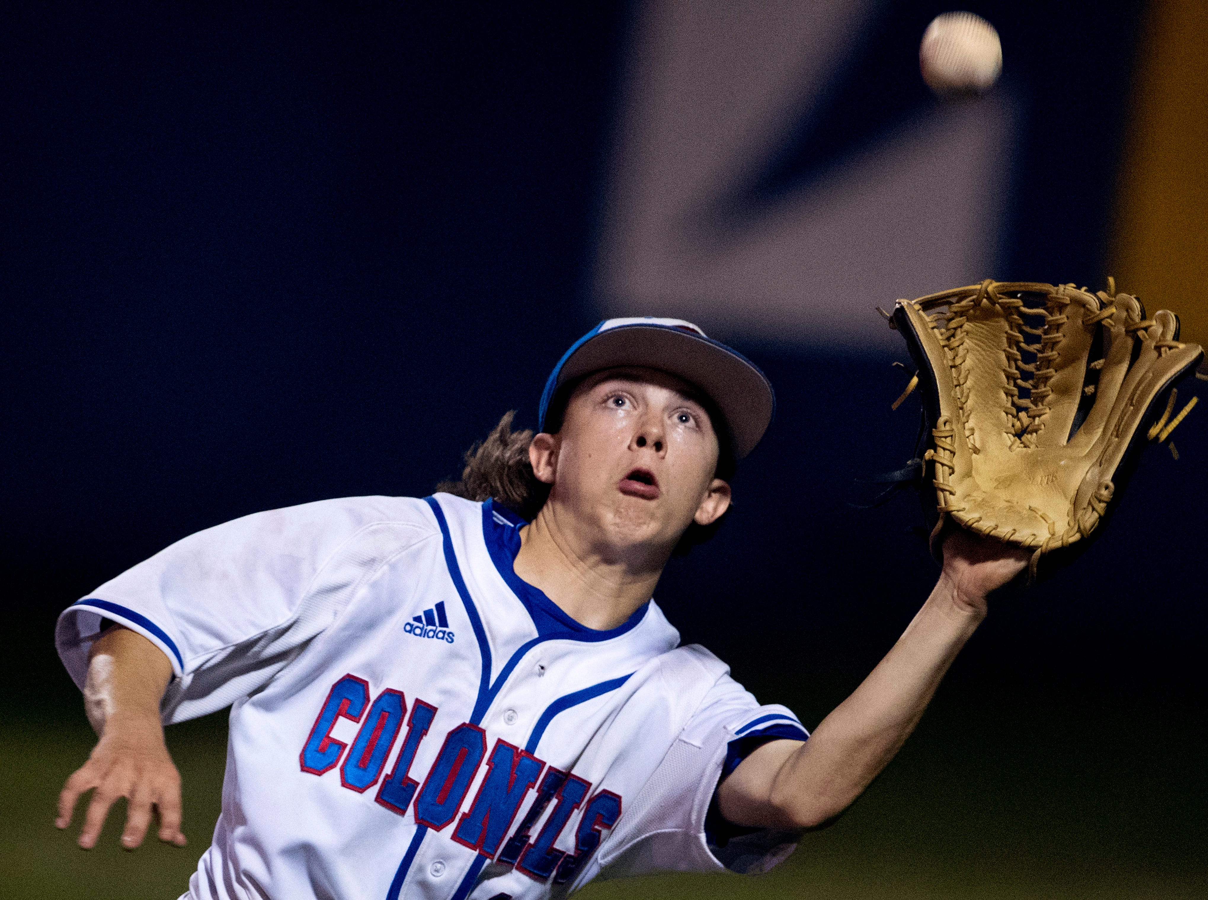 Christian County right fielder Bryson Brown hauls in a fly ball for the third out of the sixth inning in their game against Henderson County during their Second Region semifinal baseball tournament at Christian County High School in Hopkinsville, Ky., Wednesday evening.