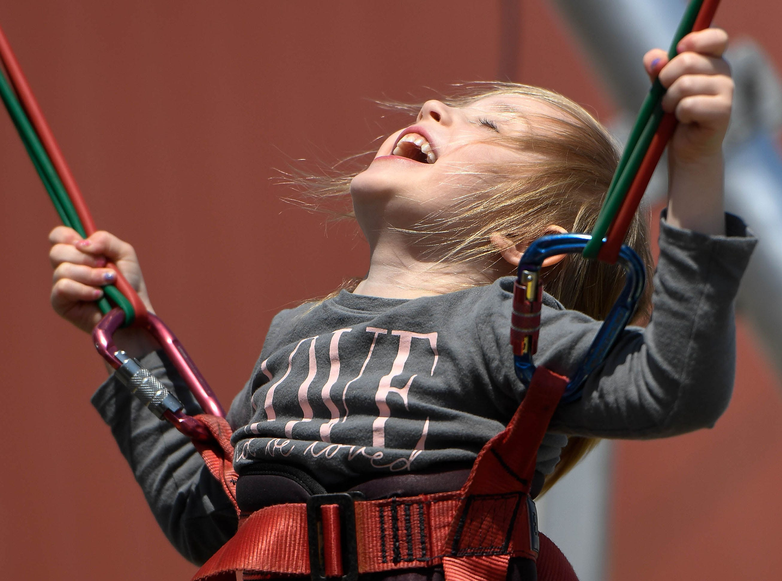Emery Shelton, 4 years-old, enjoys the bungie jump attraction at the 31st annual Henderson Breakfast Lions Club Tri-Fest Saturday, April 21, 2018.