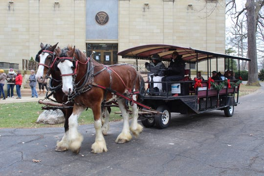 Clydesdales Sam, left, and Bass, right, take visitors at the Rutherford B. Hayes Library and Museum on a trolley ride around Spiegel Grove. The museum is offering trolley and sleigh rides from 1 to 4 p.m. through Dec. 31.