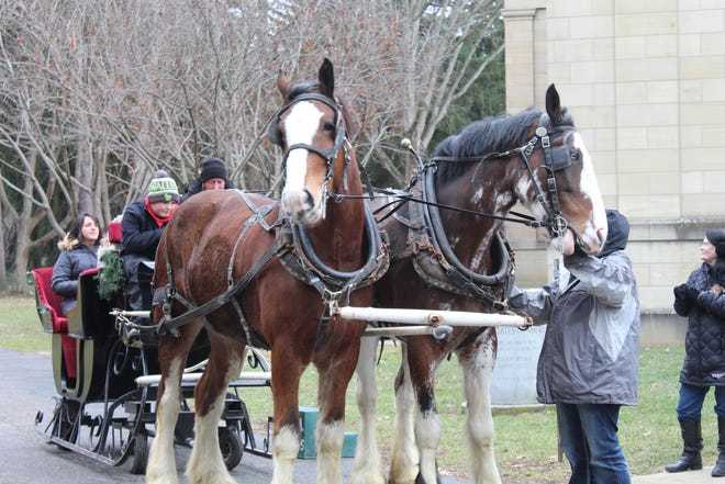 Sleigh rides are offered with or without snow on the ground at Spiegel Grove thanks to wheels attached to the four-person sleigh.