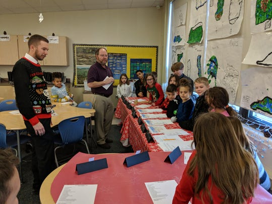 Port Clinton Mayor Hugh Wheeler advises Zach Amos's third grade  classroom at Bataan Memorial Elementary during their mock city council meeting.