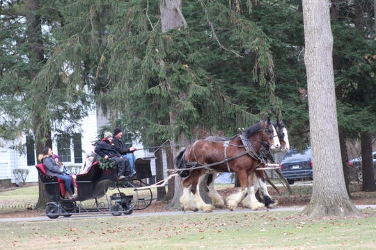 "The Steiber family, Glenn, Mandy and daughters Sophia and Grace, take their first ride around Spiegel Grove. The Monroeville family said they ""loved"" the 10-minute horse-drawn sleigh ride."