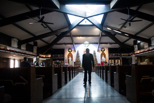 Father Don Willette walks down the aisle on Thursday, Dec. 27, 2018, at Saint John XXIII Catholic Church in Fort Collins, Colo.