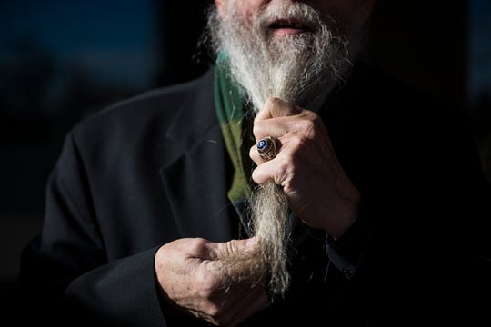 Father Don Willette straitens his beard while wearing a ring signifying his 30 years of service in the United States Air Force on Thursday, Dec. 27, 2018, in front of Saint John XXIII Catholic Church in Fort Collins, Colo.