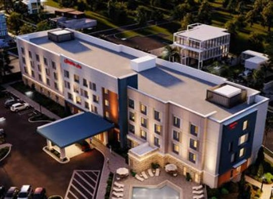Rendering of Hampton Inn planned for the intersection of Cleveland Avenue and McGregor Boulevard near the Caloosahatchee River Bridge entrance ramp in downtown Fort Myers.