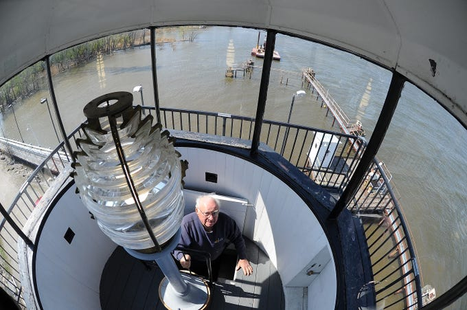 Merlin Baenen enters the lantern room of the south Grassy Island Range Lighthouse at the Green Bay Yachting Club Tuesday, May 15, 2018 in Green Bay, Wis