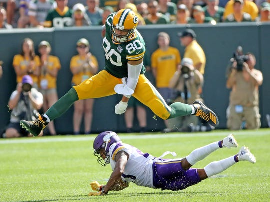 Green Bay Packers tight end Jimmy Graham (80) leaps a tackler late in the game against the Minnesota Vikings Sunday, September 16, 2018 at Lambeau Field in Green Bay, WIs.