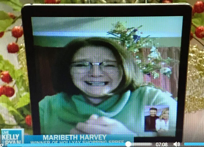 Maribeth Harvey, the mother of Oconto Schools superintendent Emily Miller, smiles as she speaks to Ryan Secreast and Kelly Ripa (seen in in the lower right corner)  on a video call last month during which Harvey was named the winner of a  $10,000 shopping spree.