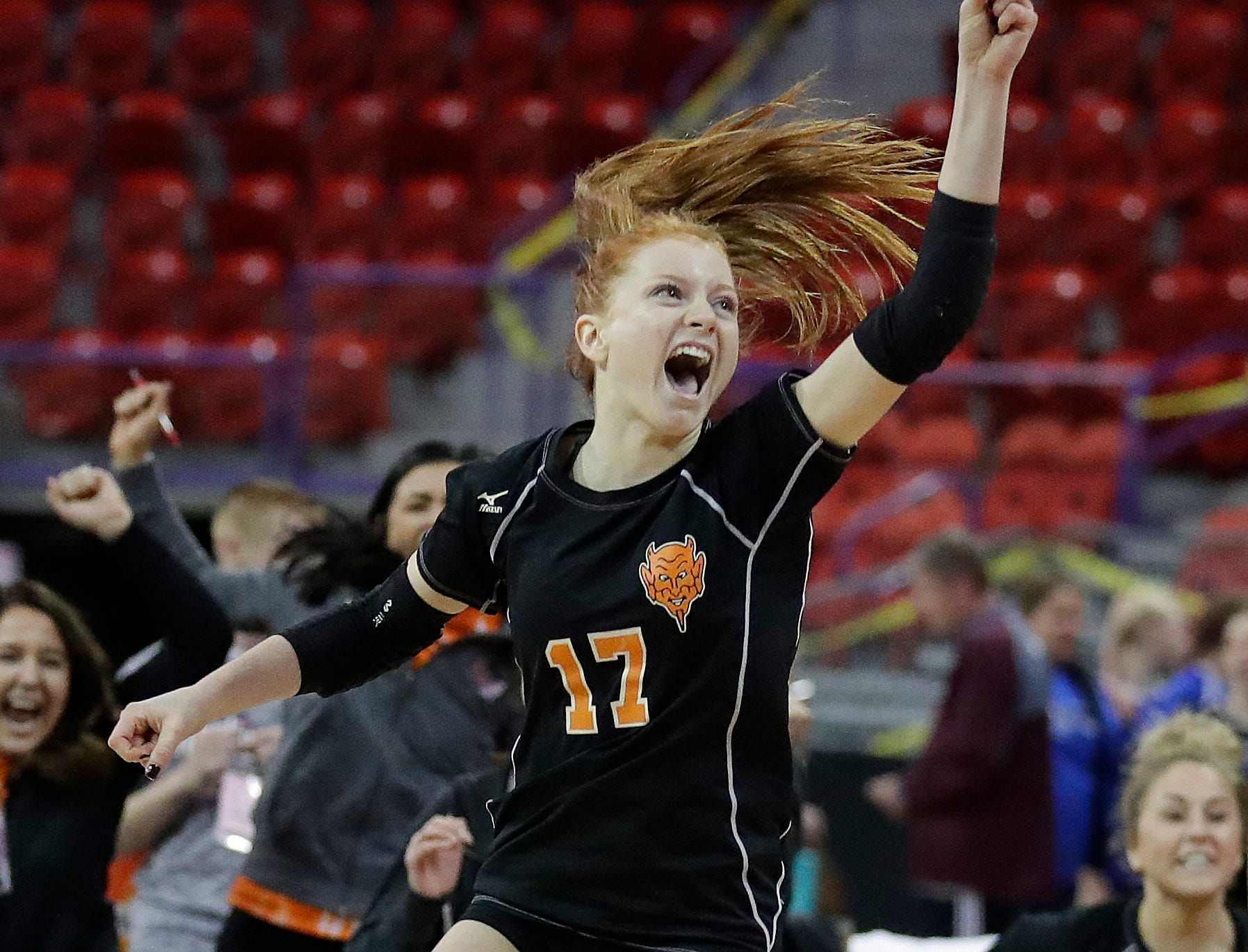 Burlington's Amanda Viel celebrates their win over 