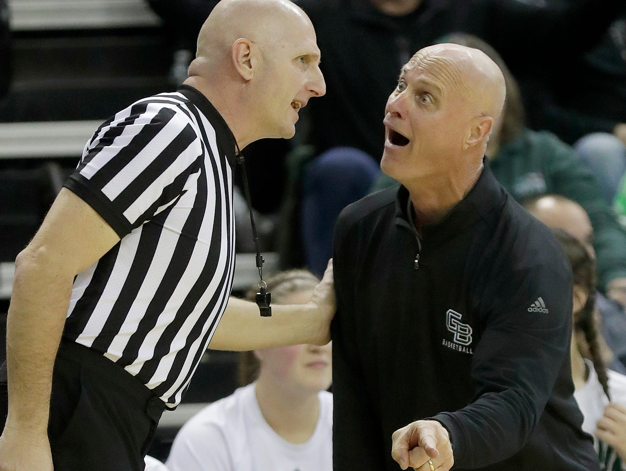 Green Bay Phoenix head coach Kevin Borseth remonstrates with the referee during the game against Wisconsin at the Kress Center, Saturday, December 8, 2018 in Green Bay, Wis.
