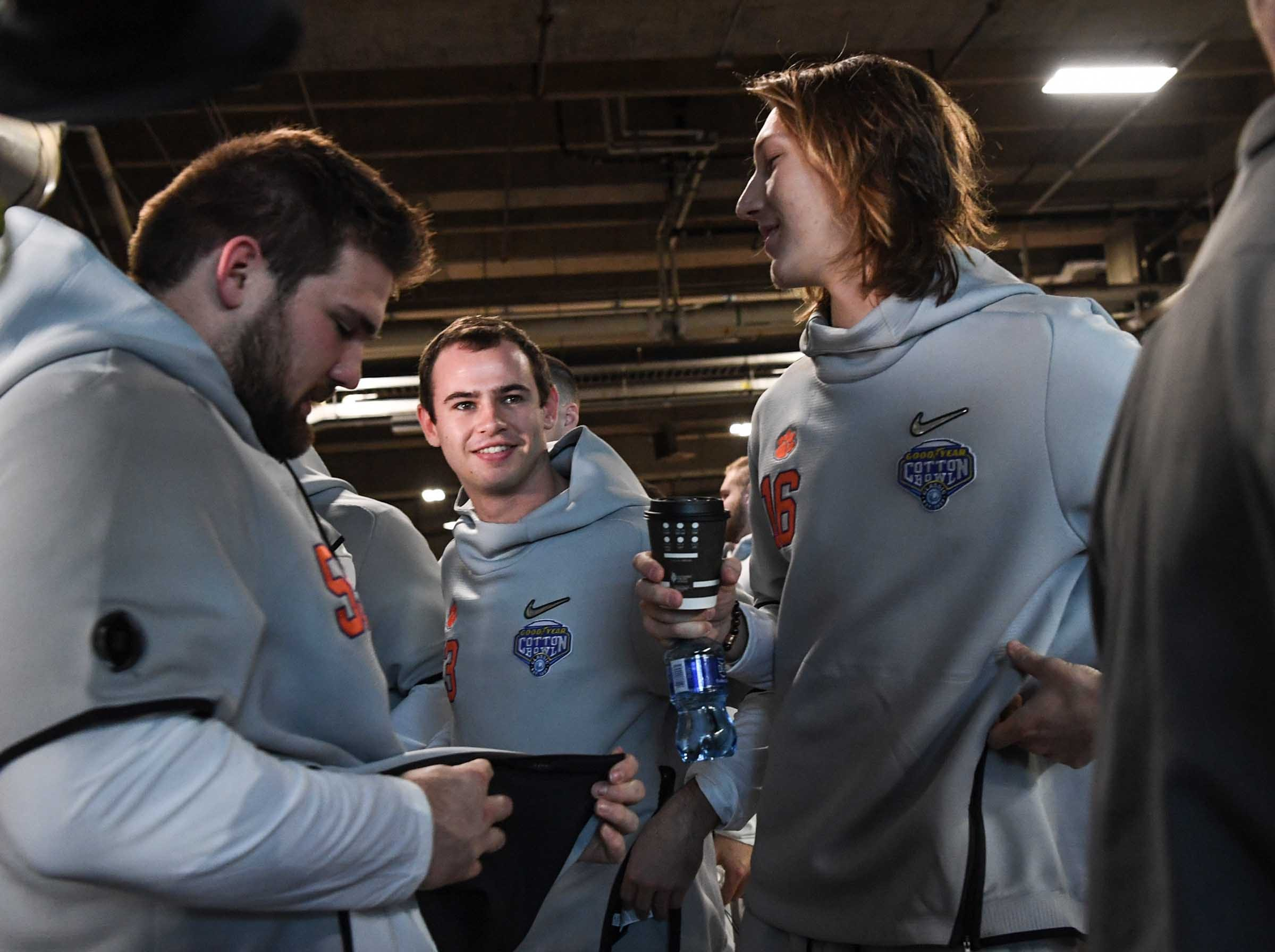 Clemson offensive lineman Gage Cervenka, left, wide receiver Hunter Renfrow and quarterback Trevor Lawrence during Media Day for Clemson and Notre Dame at the AT&T Stadium in Dallas December 27, 2018.