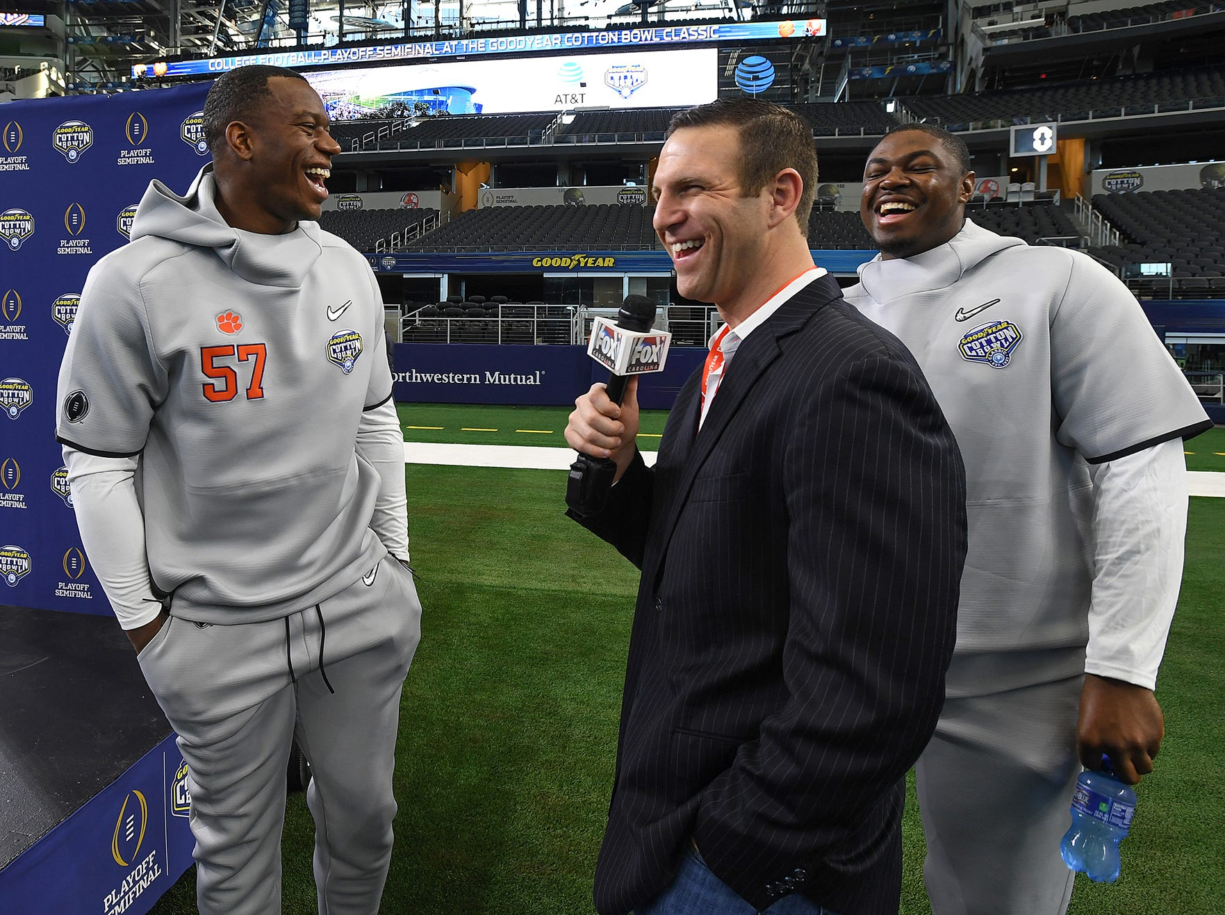 Clemson linebacker Tre Lamar, left, and offensive lineman Tremayne Anchrum laugh with reporter Aaron Cheslock during the Tigers Cotton Bowl media day at AT&T Stadium in Arlington, TX Thursday, December 27, 2018.