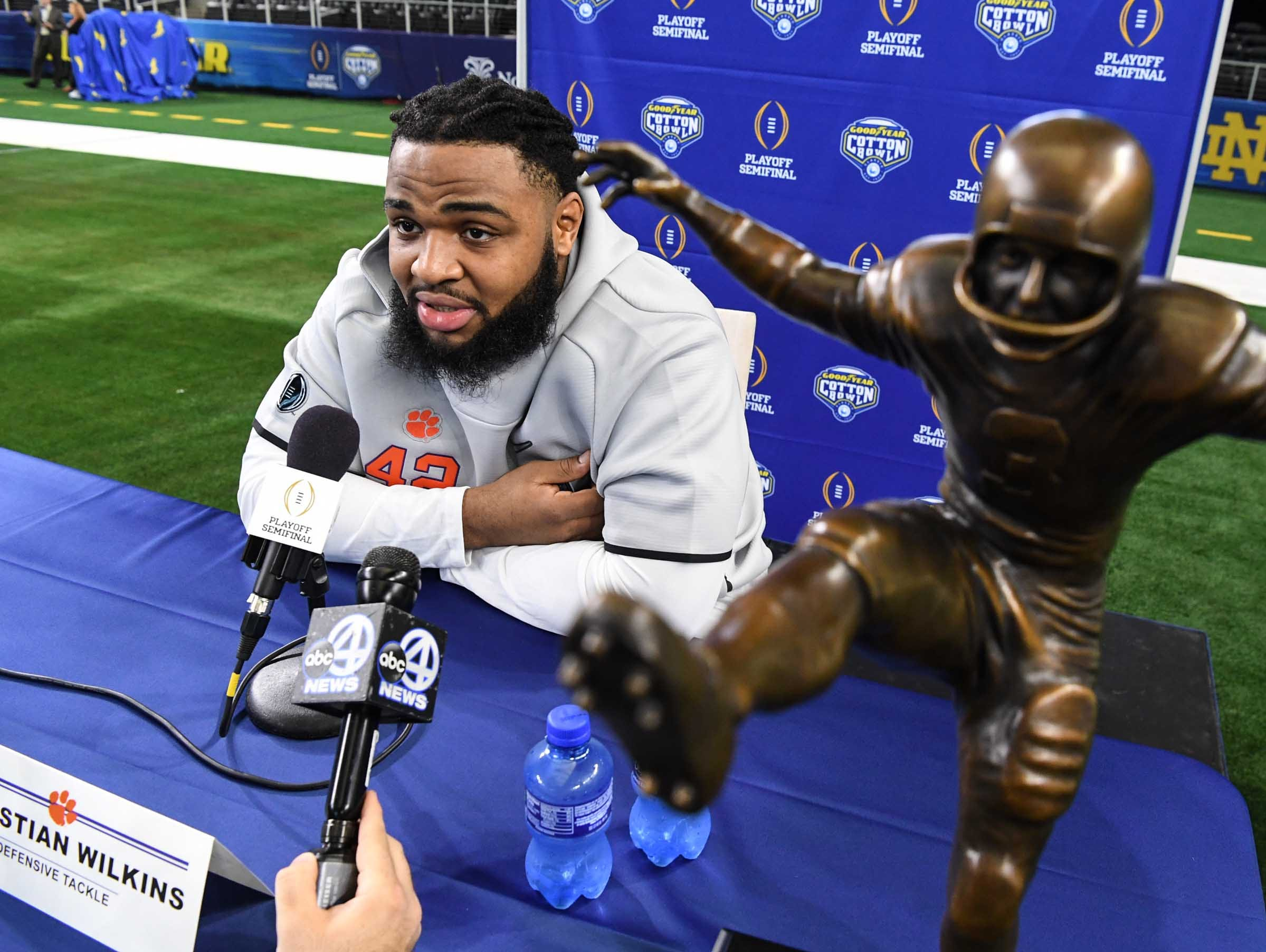 Clemson defensive lineman Christian Wilkins talks near his William V. Campbell Trophy during Media Day for Clemson and Notre Dame at the AT&T Stadium in Dallas December 27, 2018.