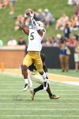 Sep 22, 2018; Winston-Salem, NC, USA; Notre Dame Fighting Irish cornerback Troy Pride Jr. (5) intercepts a pass in the third quarter against the Wake Forest Demon Deacons at BB&T Field. Mandatory Credit: Jeremy Brevard-USA TODAY Sports