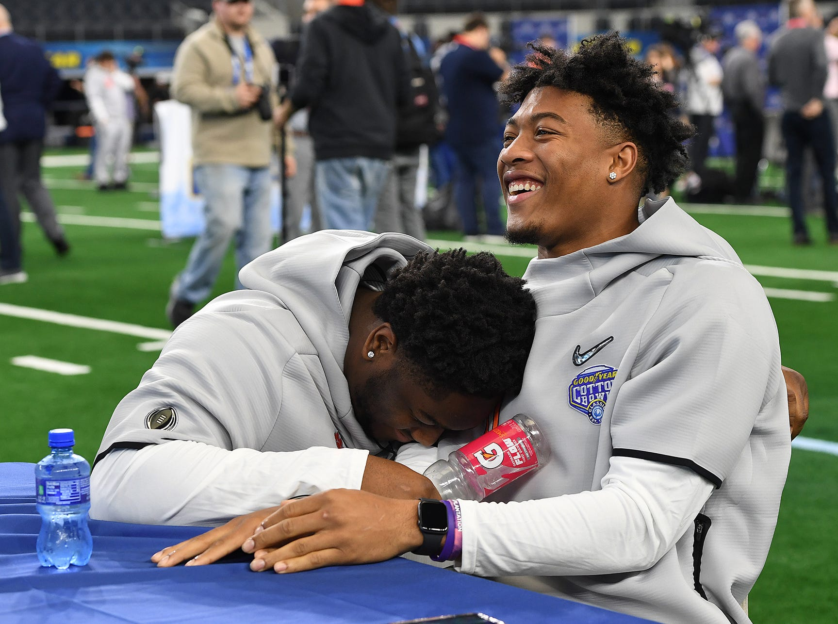 Clemson linebacker Logan Rudolph, left, laughs as he interviews safety Isaiah Simmons during the Tigers Cotton Bowl media day at AT&T Stadium in Arlington, TX Thursday, December 27, 2018.