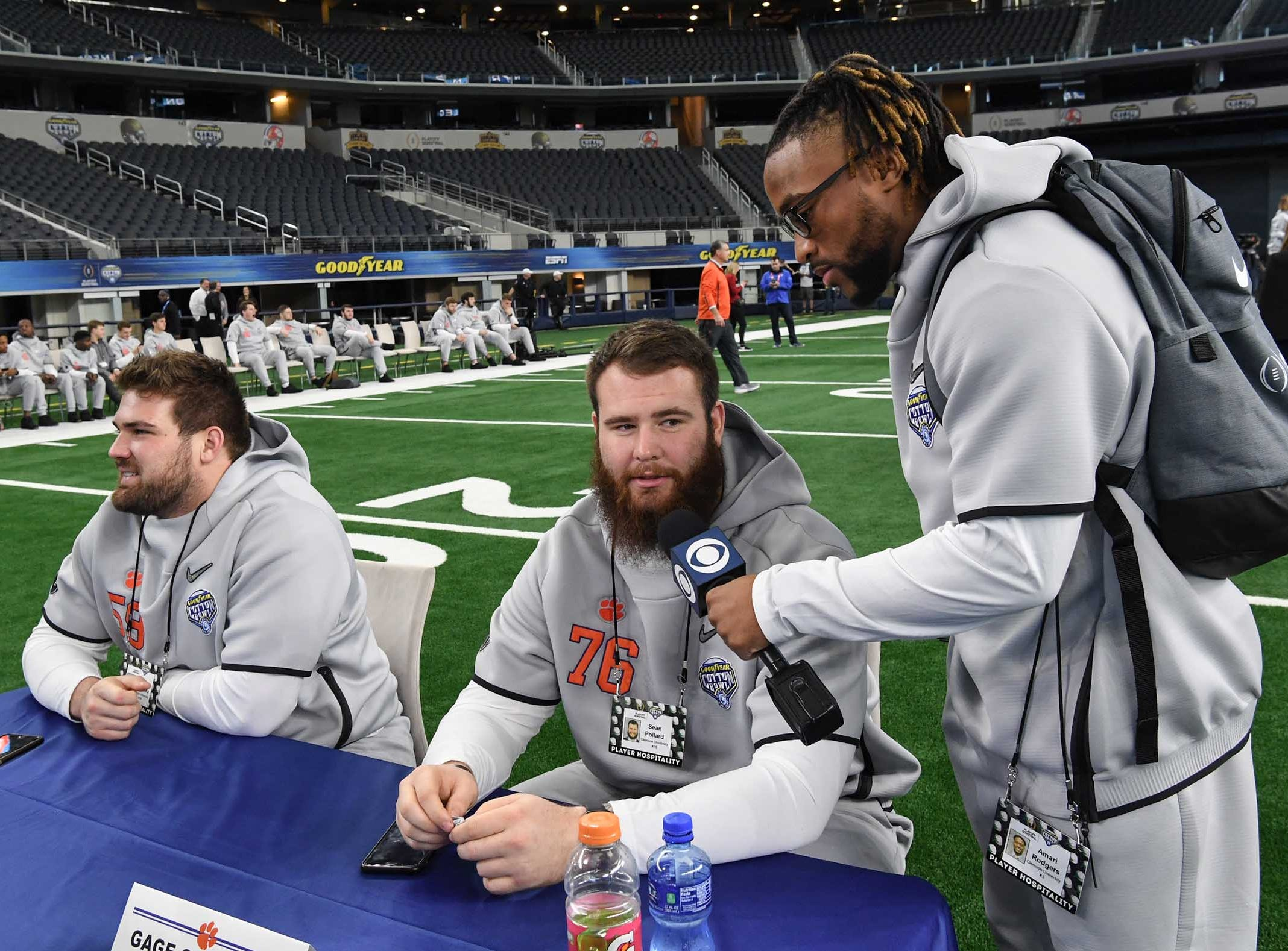 Clemson wide receiver Amari Rodgers, right, interviews offensive lineman Sean Pollard (76) during Media Day for Clemson and Notre Dame at the AT&T Stadium in Dallas December 27, 2018.
