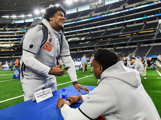 defensive lineman Jordan Williams, left, laughs with defensive back K'Von Wallace during the Tigers Cotton Bowl media day at AT&T Stadium in Arlington, TX Thursday, December 27, 2018.