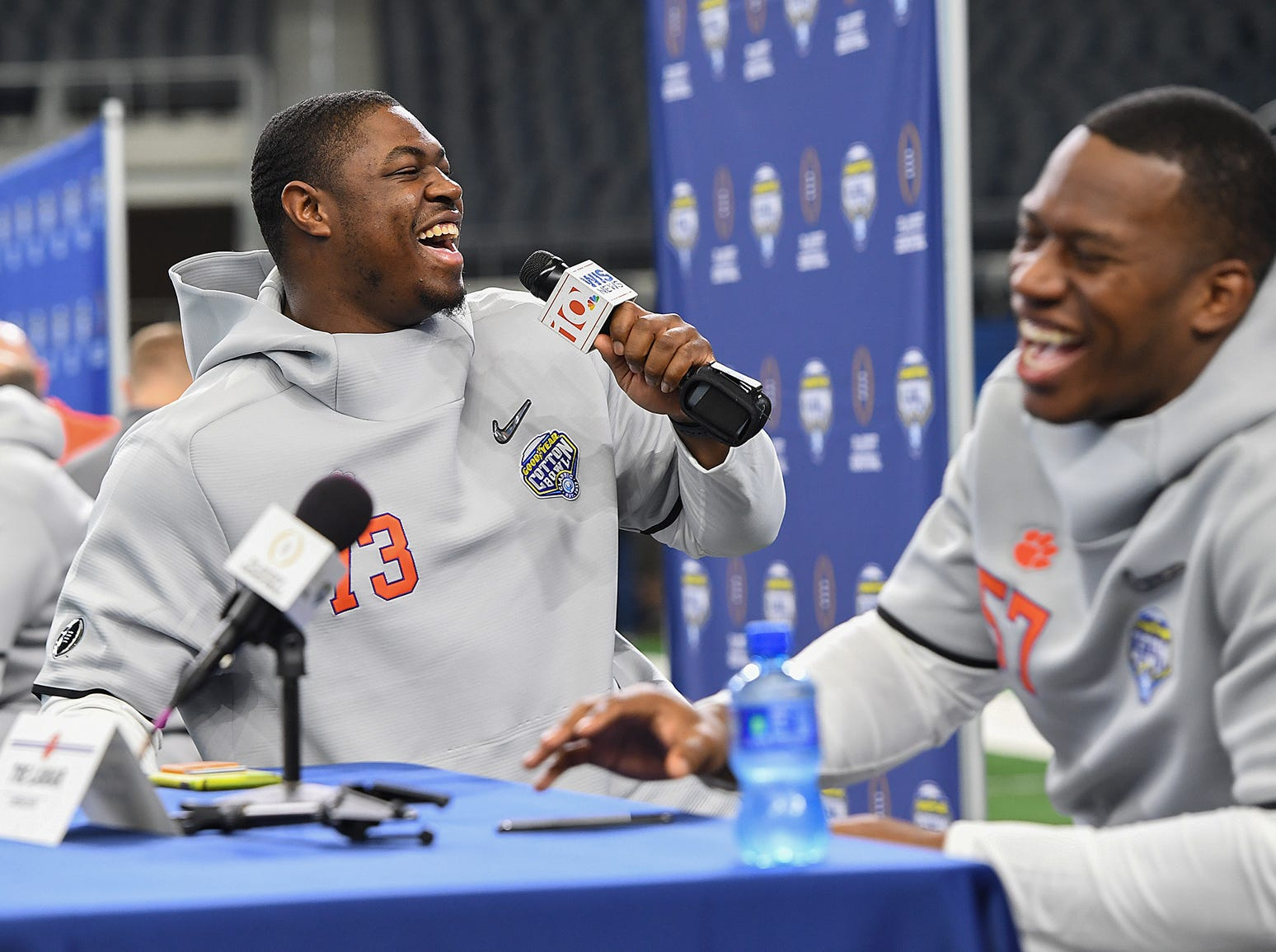 Clemson offensive lineman Tremayne Anchrum, left, laughs while interviewing linebacker Tre Lamar during the Tigers Cotton Bowl media day at AT&T Stadium in Arlington, TX Thursday, December 27, 2018.