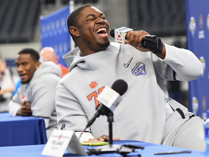 Clemson offensive lineman Tremayne Anchrum laughs while interviewing linebacker Tre Lamar during the Tigers Cotton Bowl media day at AT&T Stadium in Arlington, TX Thursday, December 27, 2018.