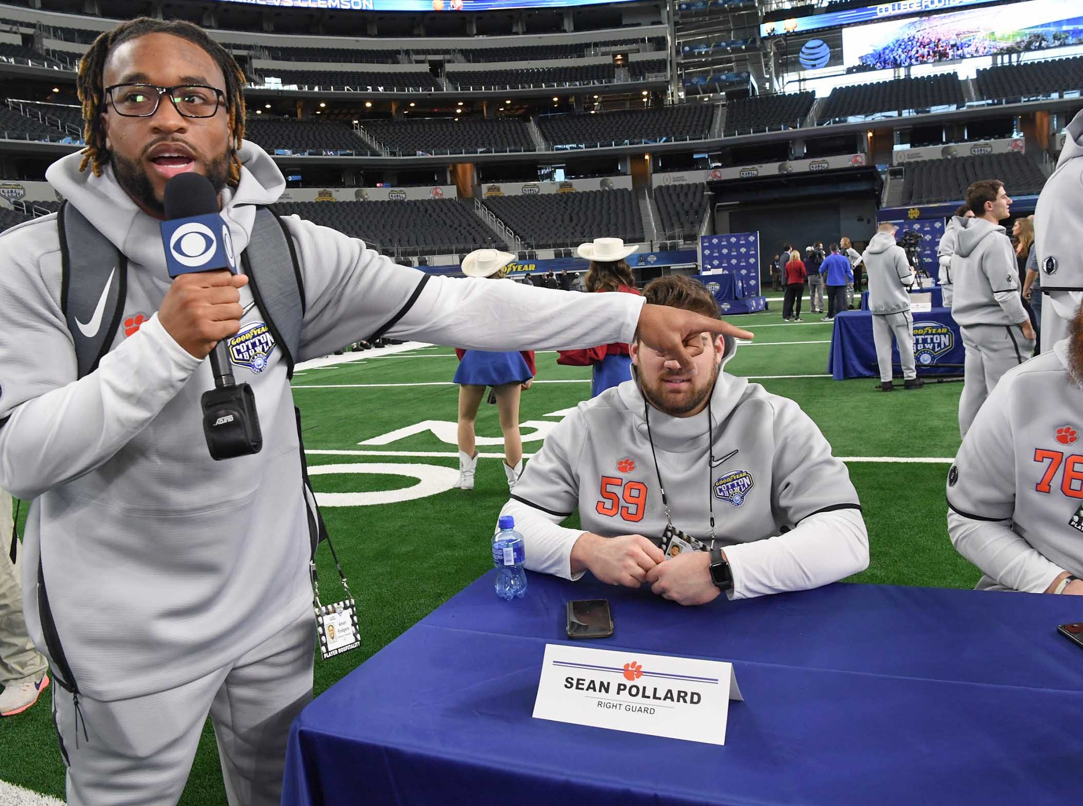 Clemson wide receiver Amari Rodgers, left, interviews offensive lineman Gage Cervenka (59) and offensive lineman Sean Pollard (76) during Media Day for Clemson and Notre Dame at the AT&T Stadium in Dallas December 27, 2018.