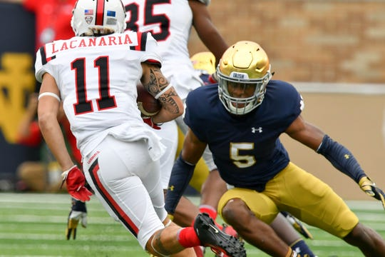 Sep 8, 2018; South Bend, IN, USA; Ball State Cardinals wide receiver Corey Lacanaria (11) carries the ball as Notre Dame Fighting Irish cornerback Troy Pride Jr. (5) defends in the first quarter at Notre Dame Stadium. Mandatory Credit: Matt Cashore-USA TODAY Sports