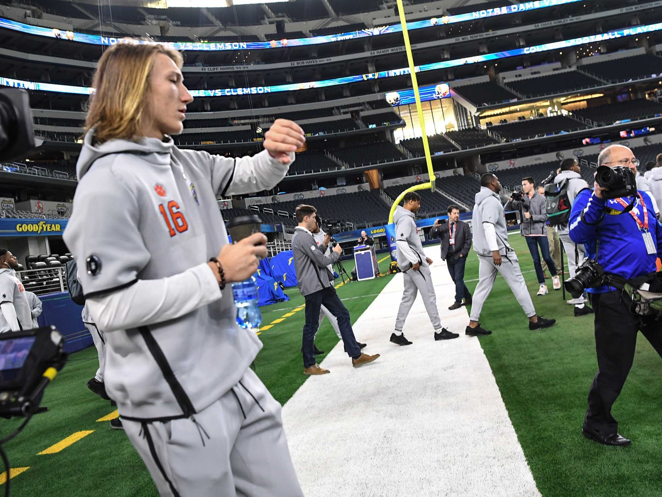 Clemson quarterback Trevor Lawrence looks at his watch entering Media Day for Clemson and Notre Dame at the AT&T Stadium in Dallas December 27, 2018.