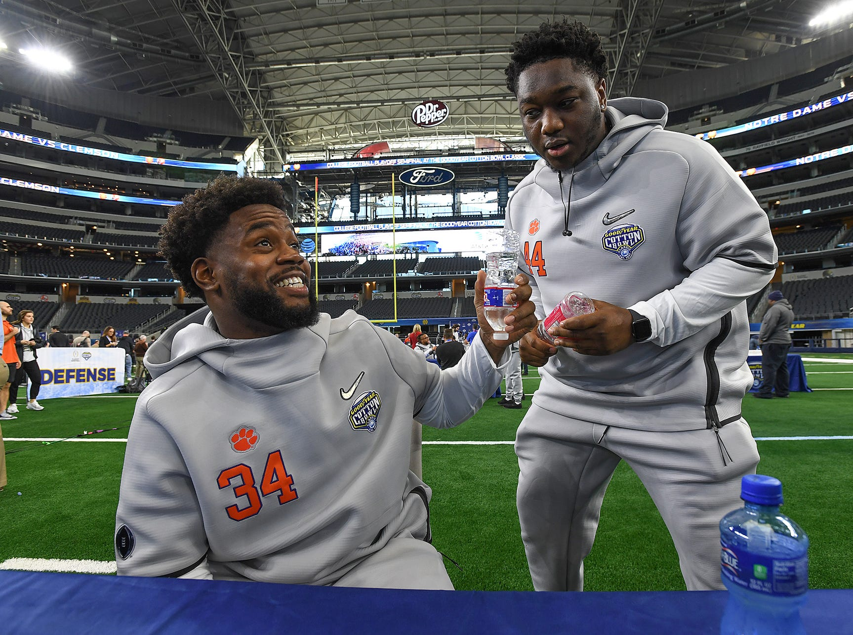 Clemson linebacker Kendall Joseph laughs with tight end Garrett Williams during the Tigers Cotton Bowl media day at AT&T Stadium in Arlington, TX Thursday, December 27, 2018.