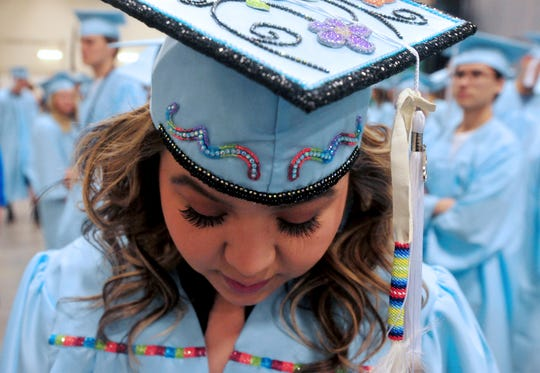 Presley Bird Rattler waits with her classmates for their Great Falls High School Class of 2018 commencement ceremony to begin on Sunday, May 27, 2018, in the Four Seasons Arena. Great Falls High graduated 224 seniors, Sunday.