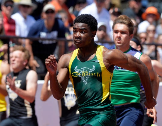 CMR's Damien Nelson records a time of 10.5 seconds in the 100m dash, which set a new state record during the Class AA and C State Track and Field Meet last at Memorial Stadium.