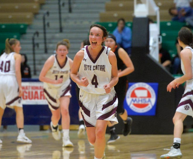 Butte Central's Kloie Thatcher celebrates a basket as she eyes the clock in the first half of the semifinal game against Hardin during the girls' Class A State Basketball Tournament at the Four Seasons Arena in Great Falls, Friday.